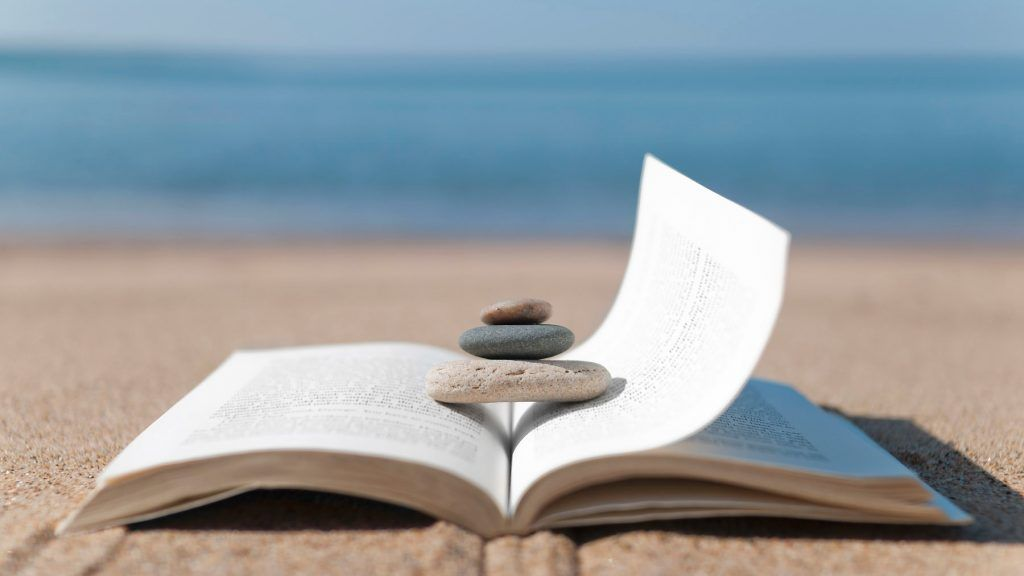 101113-lifestyle-meditation-book-beach-relax-calm-vacation-reading